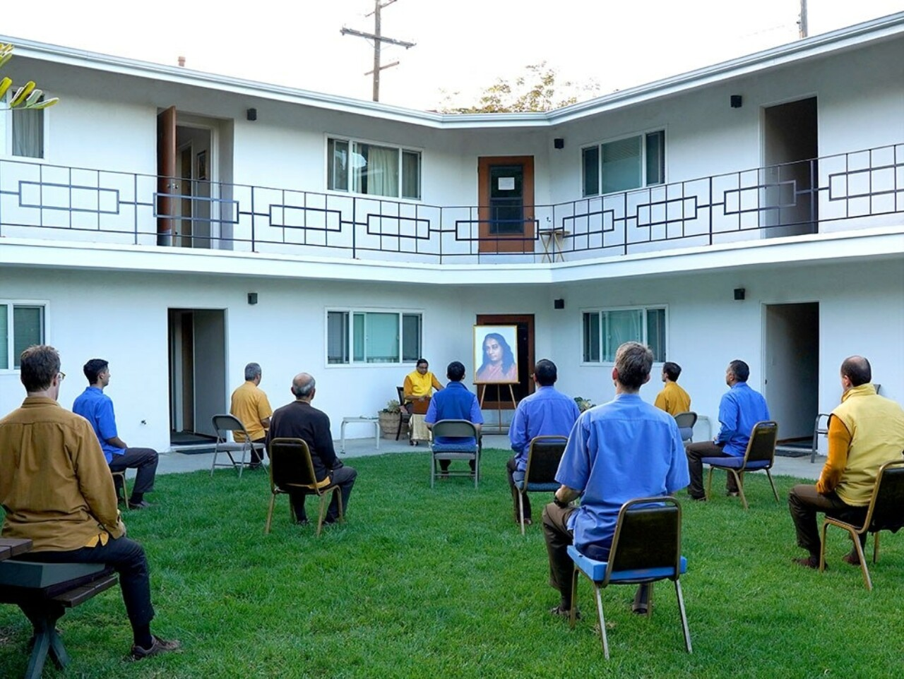 Monks meditate outside at the Mother Center