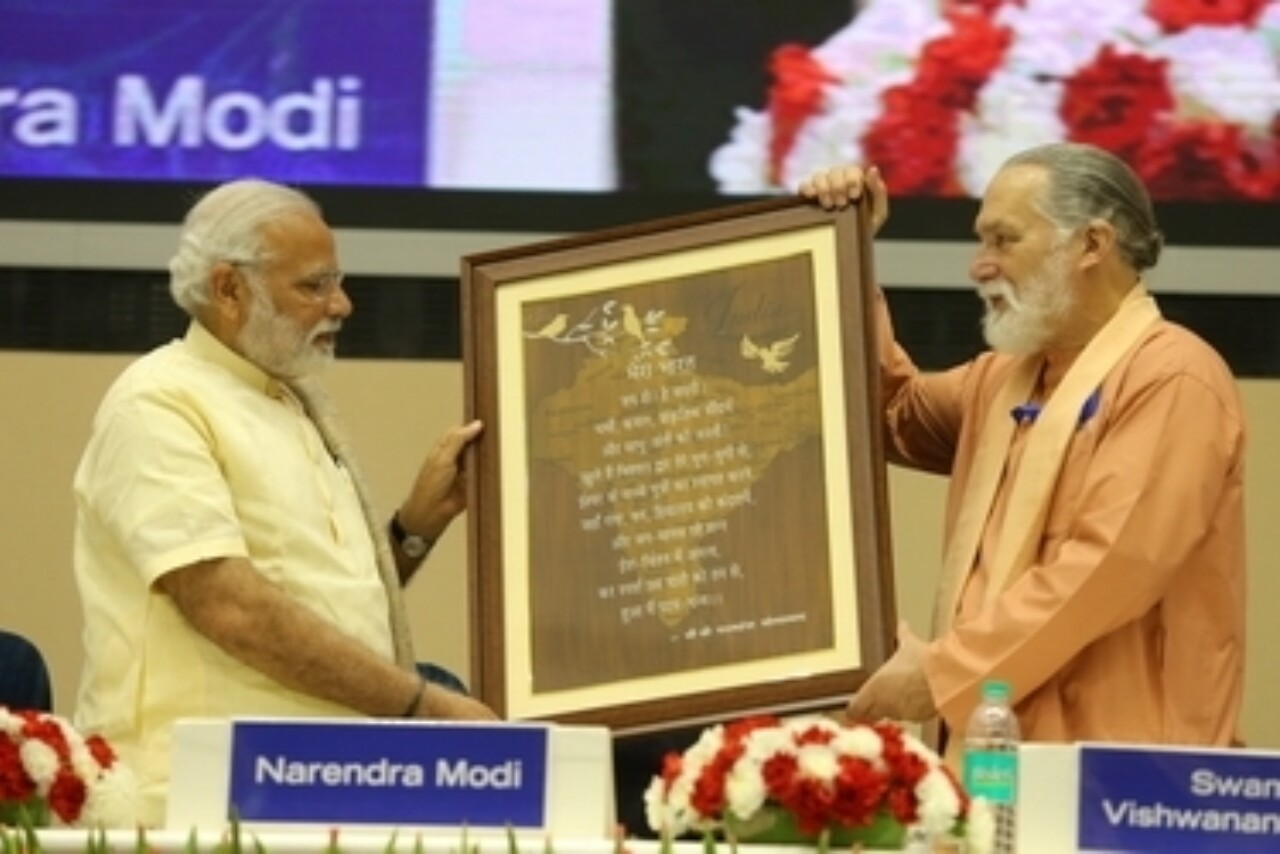 Sri Modi Receives Artistic Rendering of YSS Stamp